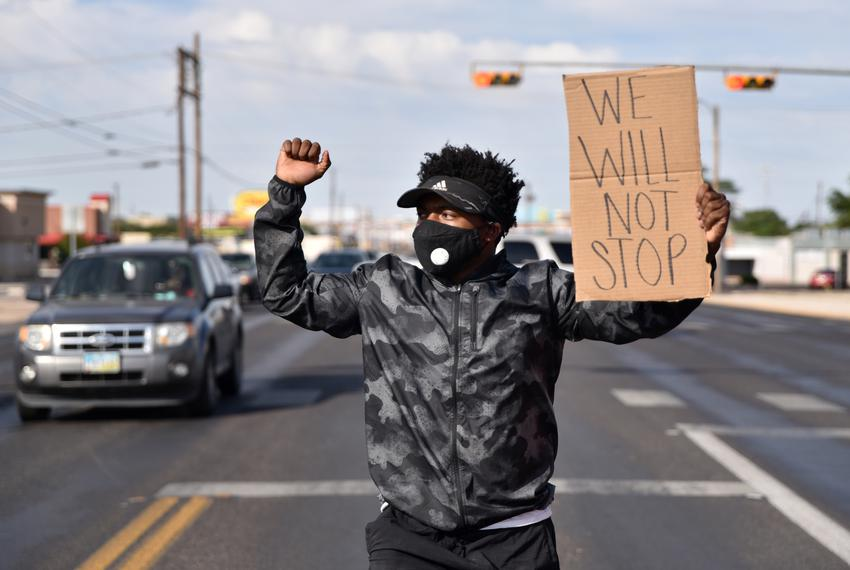 A protester walks down the middle of 8th Street in Odessa during a protest against the death of George Floyd on May 31st, 20…