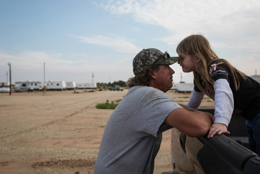 Troy Chamberlin plays with his 5-year-old daughter, Elizabeth, after returning to the RV lot at Custom Touch Village, a so-c…