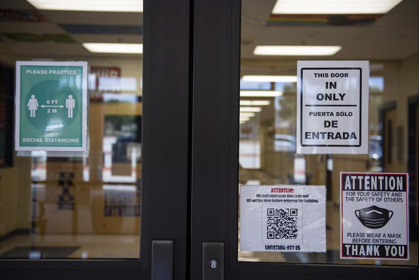 Pandemic signs are posted to the entrance to Ott Elementary School on Tuesday, Aug. 11, 2020 in San Antonio.
