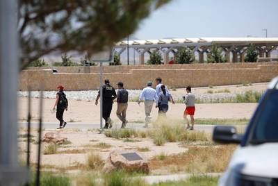 Castro, Udall and O'Rourke, accompanied by aides and a Department of Homeland Security officer, approach the tent city in Tornillo.