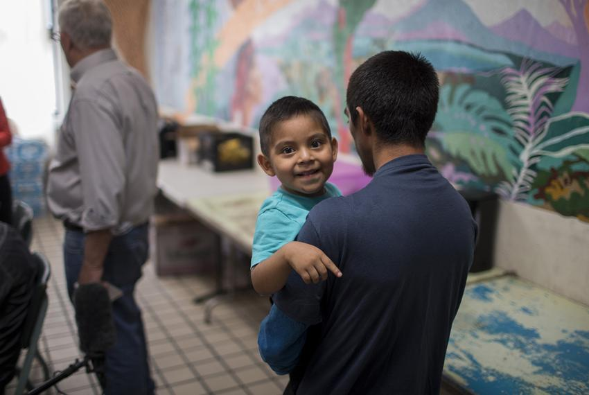 Pablo Ortiz and his 3-year-old, Andres, both from Guatemala, walk into the common area of the Annunciation House in El Paso …