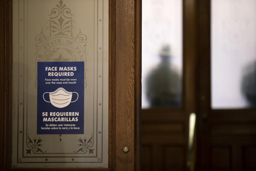 A sign states that face masks are required to enter the House gallery at the Texas Capitol on the opening day of the Legisla…