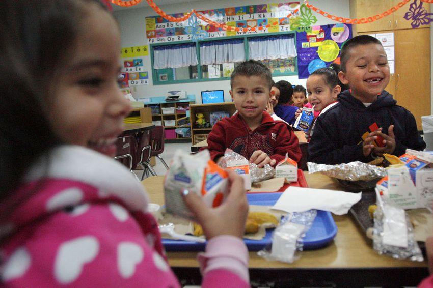 School children at Arnoldo Cantu Sr. Elementary School in San Juan, Texas, enjoy their free breakfast, April 24, 2013.