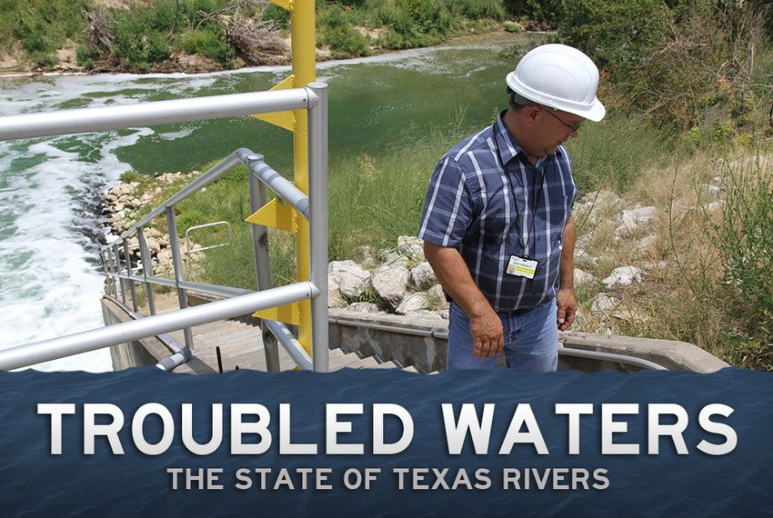 An official with Fort Worth's water department on steps that lead down to the Trinity River, where unreclaimed water from the wastewater treatment plant gets dumped.