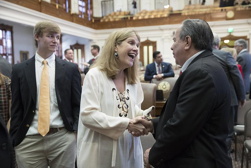 District Judge Julie Kocurek, who was severely injured in a 2015 shooting, greets state Rep. Tomas Uresti after she was me...