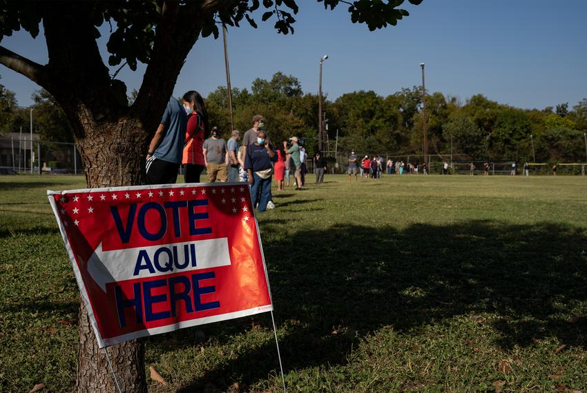 Voters waited for more than three hours to cast their ballot at the South Austin Recreation Center on the first day of early…