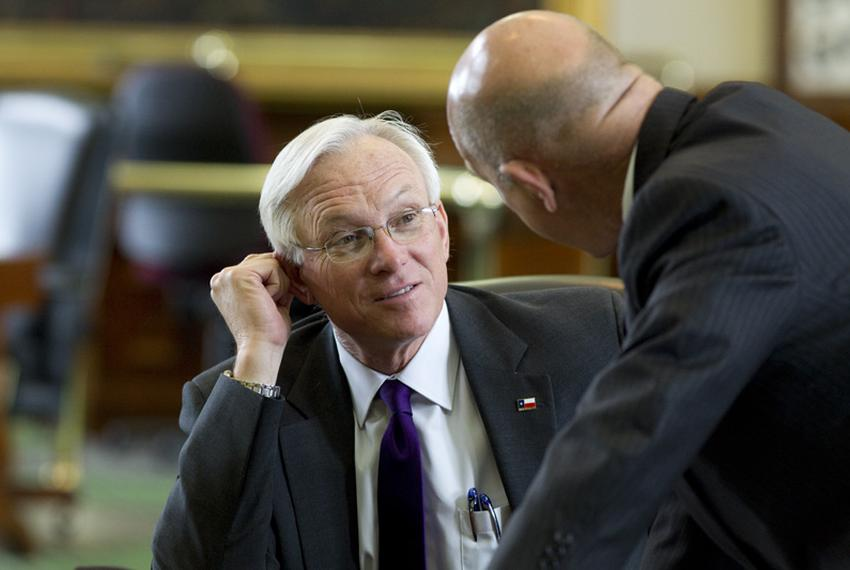 Sen. Steve Ogden (l), R-Bryan, talks with Sen. John Whitmire, D-Houston, on the Senate floor on March 29, 2011