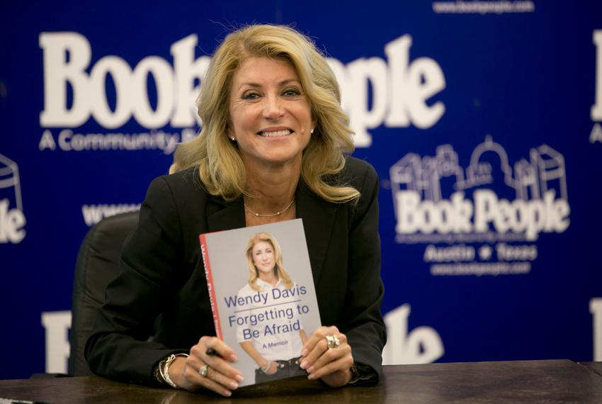 """Texas Democratic gubernatorial candidate Sen. Wendy Davis shows her book """"Forgetting to be Afraid"""" at Book People on Septe..."""