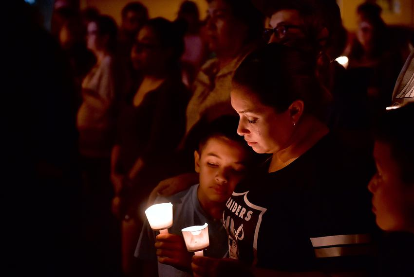 Mourners gathered for the victims of the First Baptist Church shooting at a candlelight vigil in Sutherland Springs on Sun...