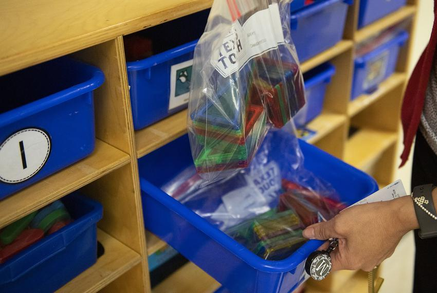 Principal Madeline Bueno shows how classroom learning materials are individually bagged in a classroom at Ott Elementary Sch…