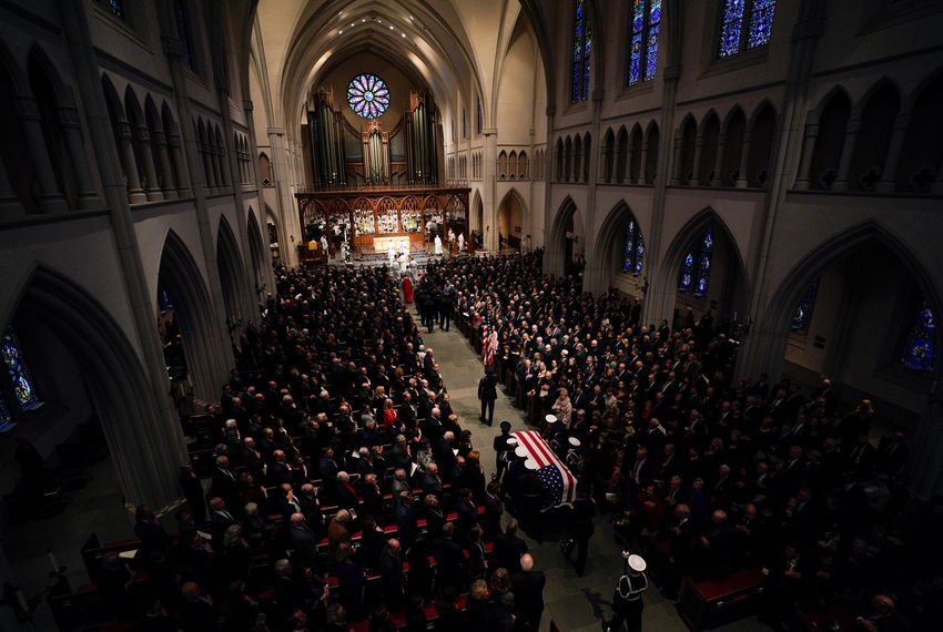 A military honor guard walks the casket into St. Martin's Episcopal Church during the funeral service for former President George H.W. Bush on Thursday in Houston.