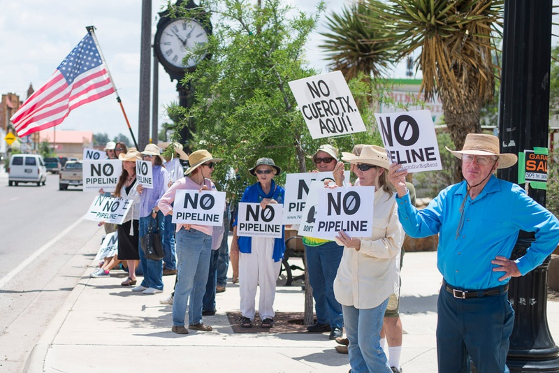 Locals protest the proposed pipeline in downtown Alpine. In some weeks, the protests  have drawn dozens of residents.
