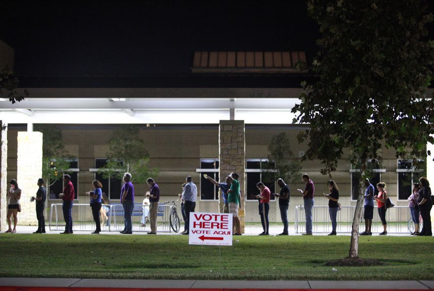 People wait to vote after polling places' official 7:00 closing time, at Tompkins High School in Katy in Fort Bend Co. on Nov. 6, 2018.