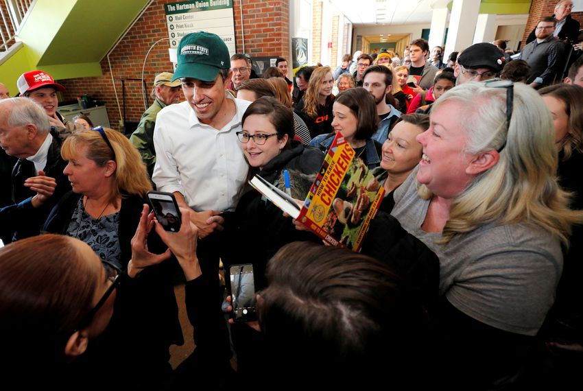 Audience members surround Democratic 2020 U.S. presidential candidate Beto O'Rourke at a campaign stop at Plymouth State University in Plymouth, New Hampshire.