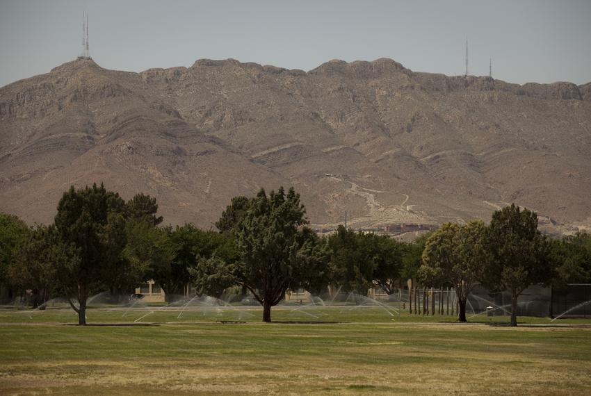 Pictured is the parade grounds with the southernmost tip of the Rocky Mountains in the background on Ft. Bliss Army installa…