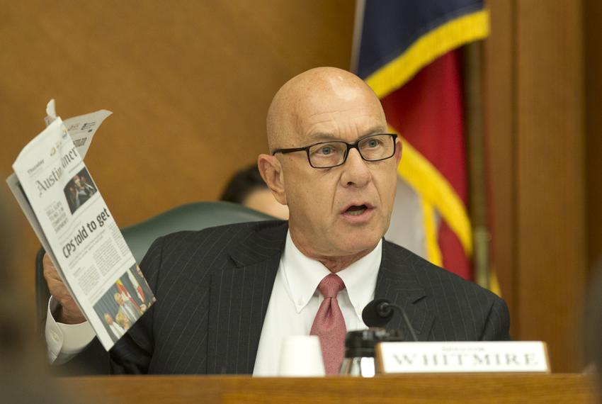Sen. John Whitmire D-Houston holds up a copy of newspaper with an article regarding CPS on the front page as he questions Jo…