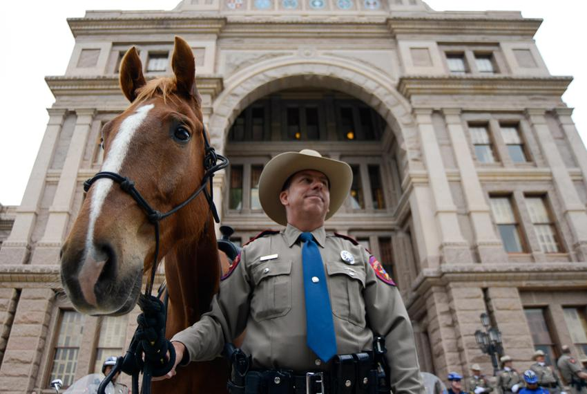 Texas Department of Public Safety officer Michael Knight and his horse Ranger stand by as the Texas DPS announces the launch…