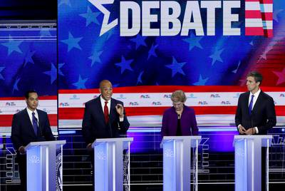 Democratic 2020 presidential candidates former HUD Secretary Julian Castro, U.S. Senator Cory Booker, U.S. Senator Elizabeth Warren and former U.S. Rep. Beto O'Rourke participate in the first U.S. 2020 presidential election Democratic candidates' debate in Miami, Florida on June 26, 2019.