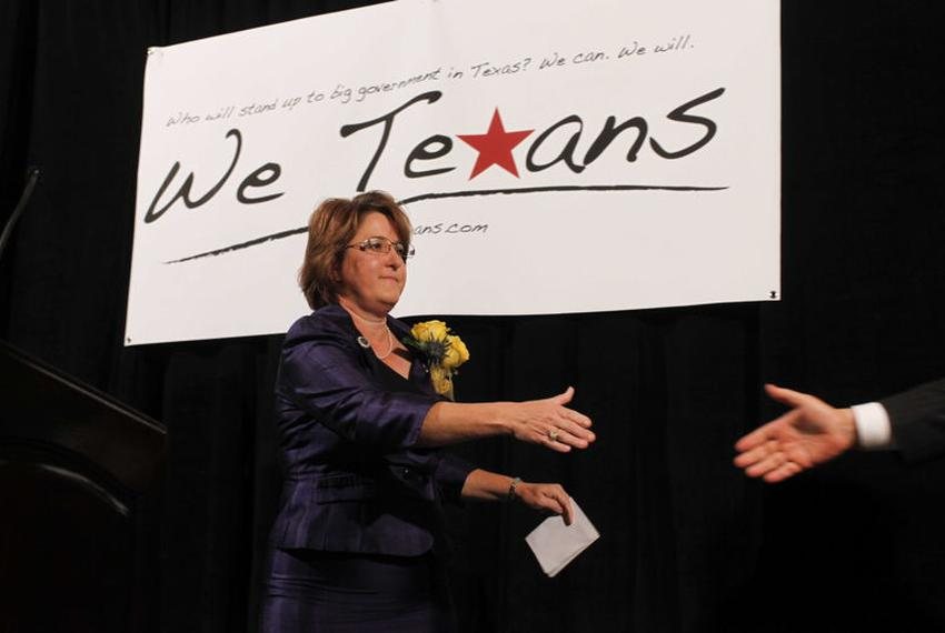 Debra Medina on stage, after introducing another speaker at a We Texans rally during the state GOP convention.