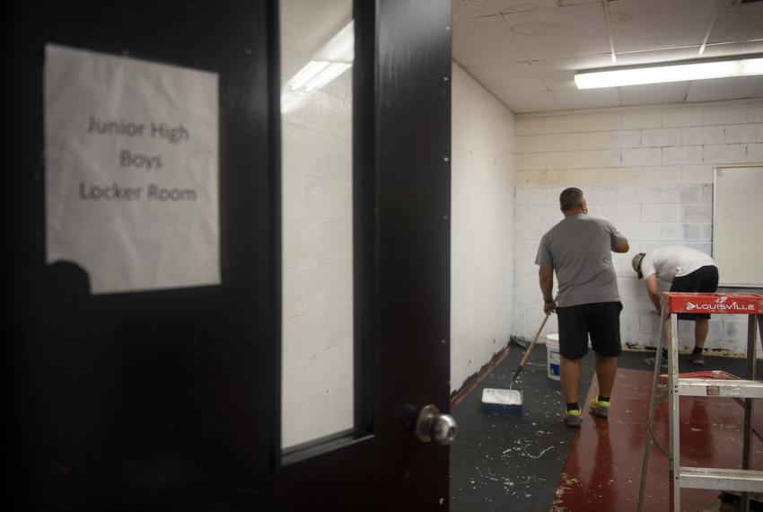 Coaches paint a locker room at Premont Collegiate High School on Tuesday, Aug. 4, 2020 in Premont. The locker room is being …