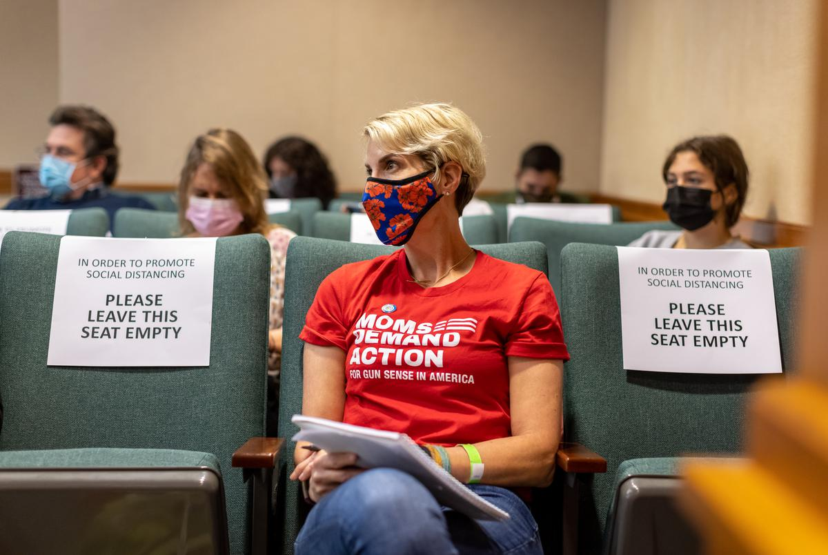 Houston Resident Kellye Burke, a volunteer for the gun safety group Mom's Demand Action, waits to testify at a Senate committee hearing on the permitless carry of handguns on April 29, 2021.