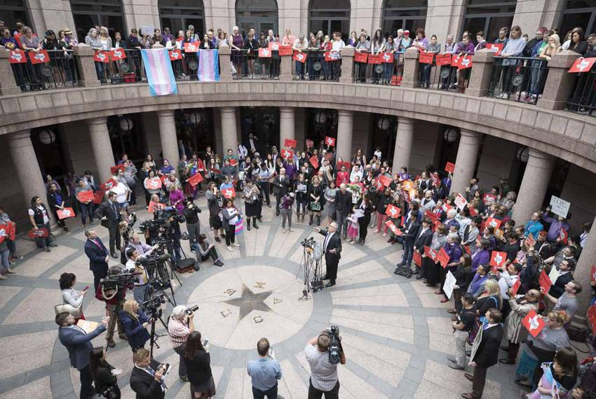 A large crowd of transgender advocates opposed to SB 6 the bathroom bill converge on the Capitol Extension Rotunda during ...