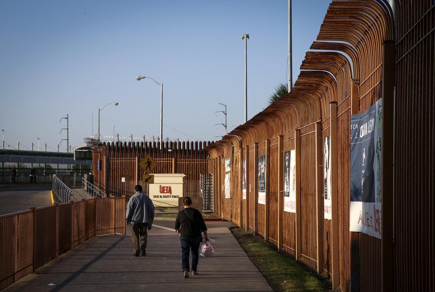 People cross the Mc Allen-Hidalgo International Bridge in Hidalgo.