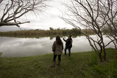 Yvette Gaytan and her neighboor Naida Alvarez  stands close to the Rio Grande river on Alvarez  property in La Rosita, Texas. Both women have received letters from the U.S. Government regarding her land as a potential location for the Border Wall