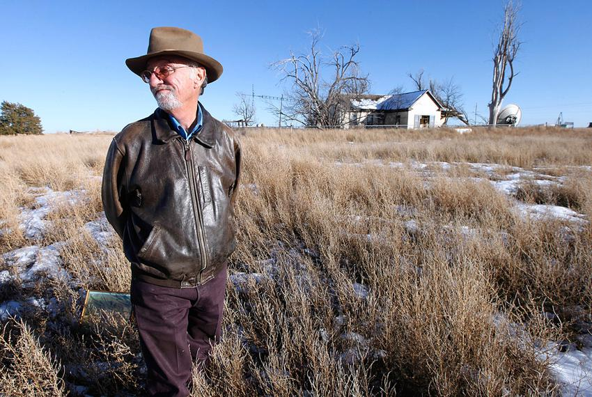 Mike Skinner on Dec. 26, 2013 outside the farmhouse on the land five miles east of Spearman that he sold last spring. Three …