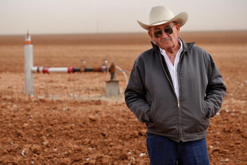 Tommy Fondren in his cotton field near a well pumping station in Lorenzo, TX, on Mar. 8, 2012