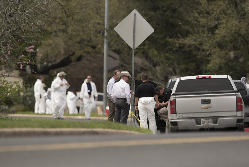 Law enforcement officials work into the afternoon on Monday, March 19, 2018, following a fourth package bomb explosion Sunda…