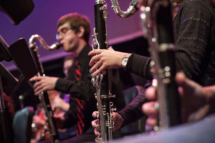 """Students of """"Wind Ensemble 1,"""" rehearse in the auditorium of Bowie High School in Austin, Texas."""