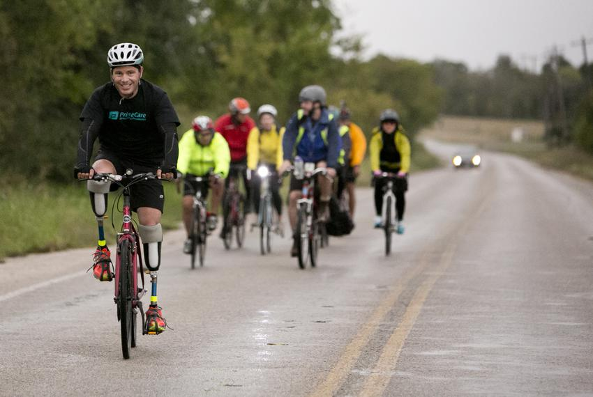 Gutierrez rides ahead on his way into Austin. His trip started with with three other cyclists, but others joined at differen…