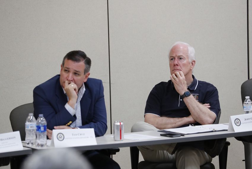 U.S. Sens. Ted Cruz (left) and John Cornyn listen at a a roundtable discussion at a South Texas border patrol station in Weslaco on June 22, 2018.