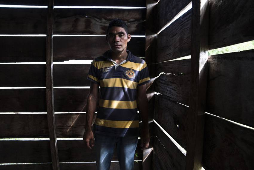 """Honduran migrant José, 40, who asked for his last name to be omitted because he fears for his family's safety, says he traveled with a migrant caravan that started in Honduras with approximately 2,000 people, separate from the one currently traveling through México. He says he can only afford one or two meals per day for his family: """"It just breaks my heart when my kids ask, 'Dad, I am hungry, what are we going to eat?'"""" He adds that he was earning the equivalent of $84 per week and had to pay $42 between two different gangs. José could not afford to support his family with $42 per week. In a migrant shelter in the community Nuevo Francisco León near Palenque, Chiapas on Oct. 23."""