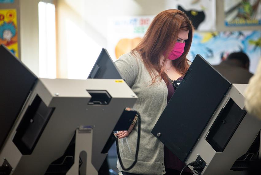 Voters cast their ballots at Audelia Road Branch Library on the first day of early voting in Dallas on Oct. 13, 2020.