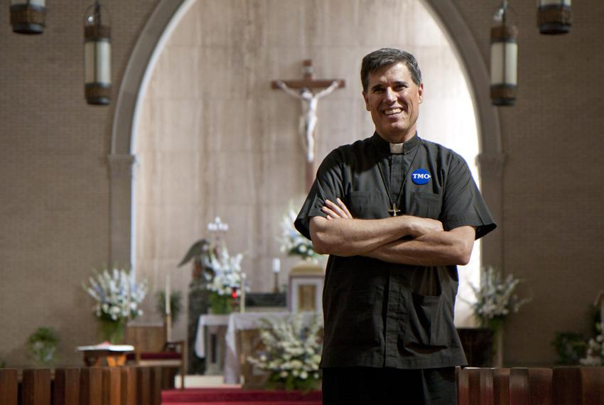 Co-director of the Metropolitan Organization Kevin Collins standing in Immaculate Conception Church where he serves as a pri…