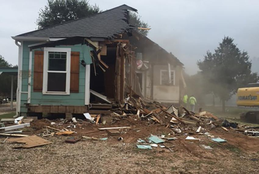 Randa Langerud's Wharton home being demolished due to damage sustained from Hurricane Harvey. Langerud's home was the firs...