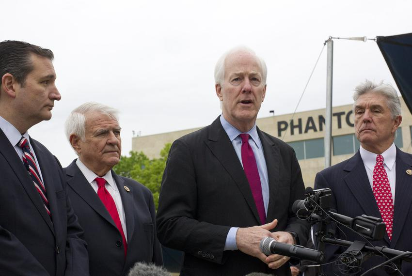 U.S. Sen. Ted Cruz, U.S. Rep. John Carter, U.S. Sen. John Cornyn and U.S. Rep. Roger Williams speak to reporters after the...