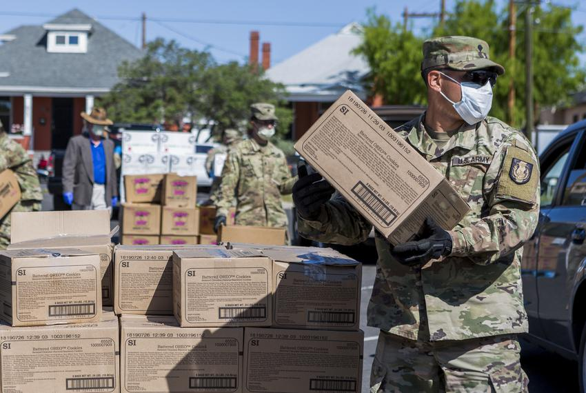 Members of the National Guard hand out food at the Kelly Memorial Food Pantry in Central El Paso during the Coronavirus pa...