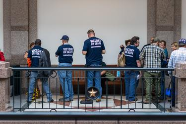 Gun rights advocates wait to testify at a Senate committee hearing regarding the permitless carry of handguns on April 29, 2021.