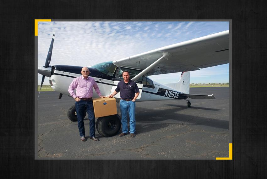 From left, Bryan Rose and Scott Gloyna deliver medical supplies via airplane to the city of Monahans.