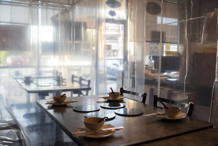 Houston, Texas: Bowls are placed inside curtained off areas at the Shabu House on June 16, 2020 in Houston, Texas. Mark Fe...