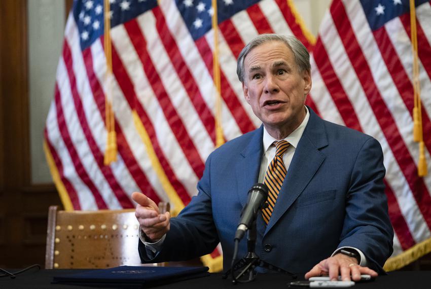 Gov. Greg Abbott signs Senate Bill 2 and Senate Bill 3 at the Texas Capitol on June 8, 2021. The omnibus power grid bills wi…