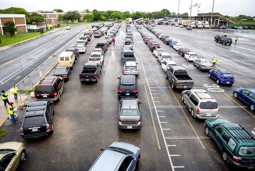 People in over 3,000 vehicles made their way to the parking lot of Nelson Field at Northeast Early College High School in ...