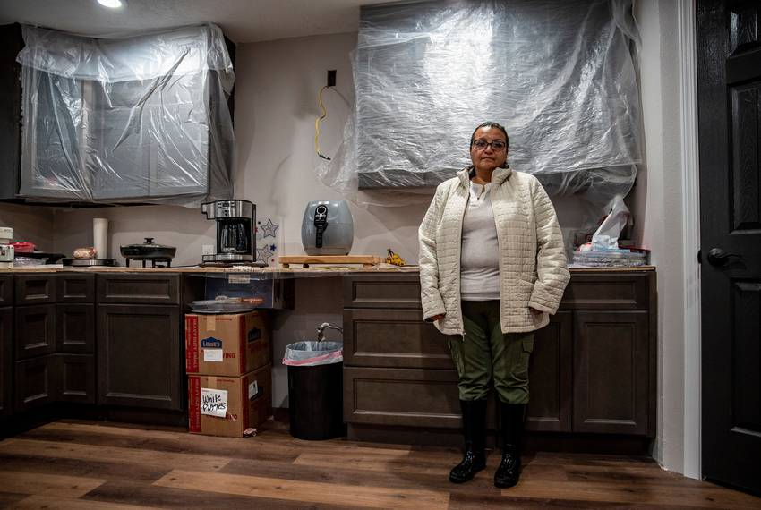 Christine Lopez in her kitchen in Friendswood on Tuesday, Dec. 10, 2019. The home was severely damaged by flood water as a...