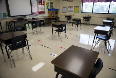 Desks are spaced out in a classroom at Ott Elementary School on Tuesday, Aug. 11, 2020 in San Antonio. The arrows on the floor indicate the direction for students to walk to control the flow of traffic through the classroom.