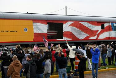 Spectators cheered and waved flags as the Union Pacific funeral train carrying the casket of former President George H.W. passed through Navasota.