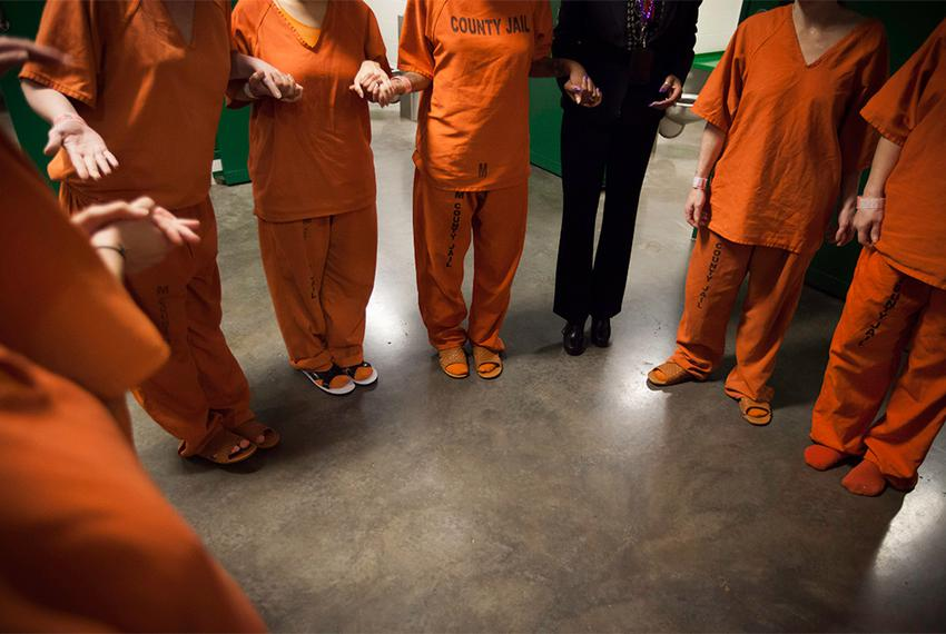 Pregnant and just postpartum inmates join hands in a circle after their life skills session in the pregnancy tank at the Har…