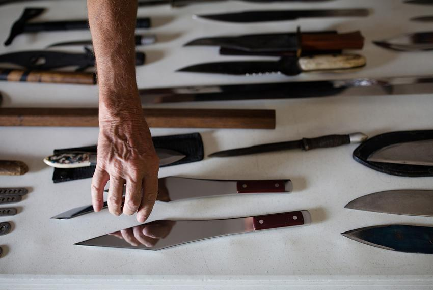 Cliff Hill, knife collector and world champion knife thrower, shows his collection at the International Knife Throwers Hal...